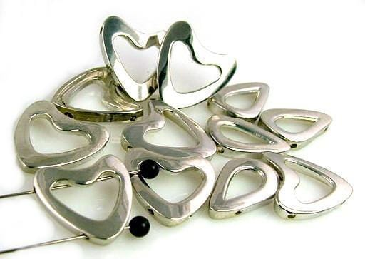 12 Unique Slider Beads that are  Silver Cast Metal  6096