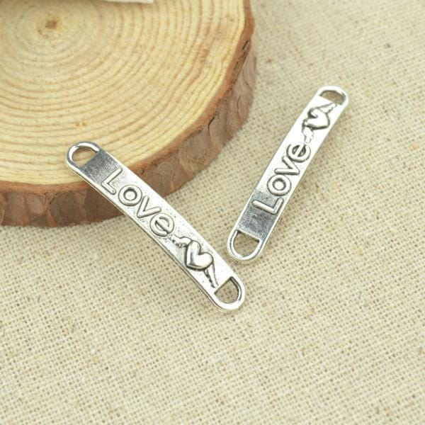 "15 pcs 38*6 mm Antique Silver with the raised word ""Love"""