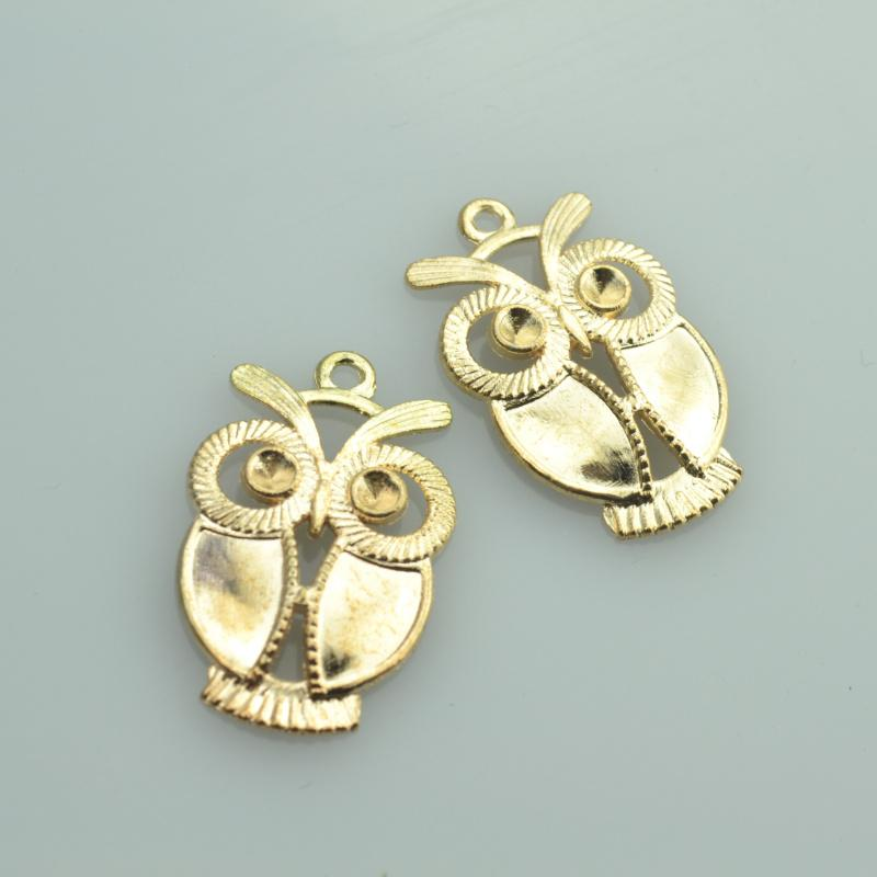 10 pcs  gold charms that are shaped as owls