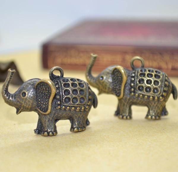 5Pcs antique gold elephants with a rug on its back