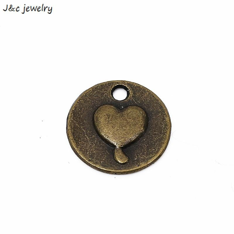 25pcs antique bronze with a small raised heart 15*15mm