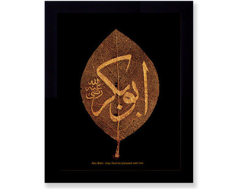 ABU BAKR, may God be pleased with him. Photographic Reproduction of Dried Natural Leaf with Arabic Calligraphy.   Overall Frame Size 11 x 9 inches. Image Size 10 x 8 inches.