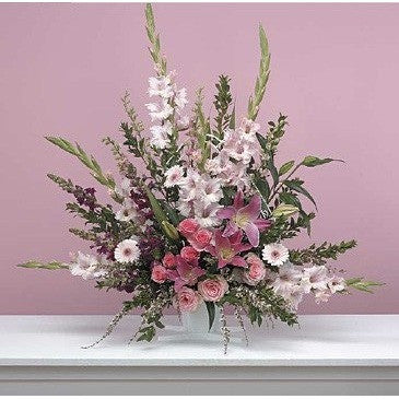Pastel Color Flowers Sympathy Basket Spray - Flowers by Pouparina