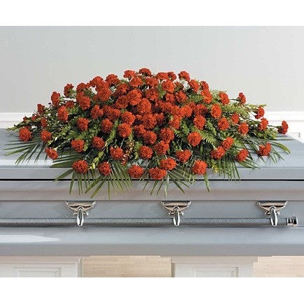 Red carnations full couch sympathy casket - Flowers by Pouparina