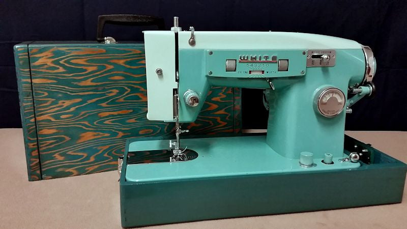 Turquoise vintage sewing machine case