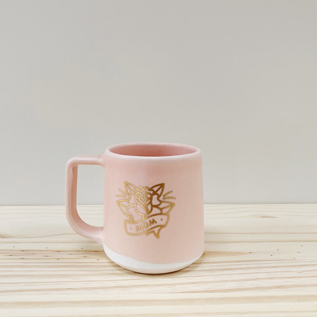 Handmade ceramic mug with 22k Gold 'Mom' design (Made to order), shown in peach.