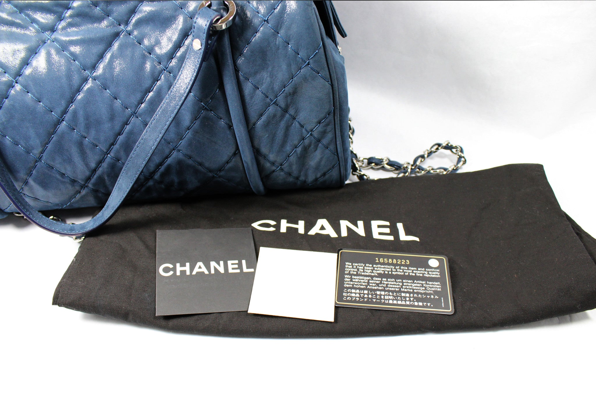 Chanel Metallic Blue Leather Quilted Duffle Bag - Encore Consignment - 14