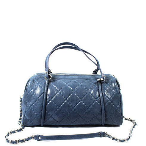 Chanel Metallic Blue Leather Quilted Duffle Bag - Encore Consignment - 1