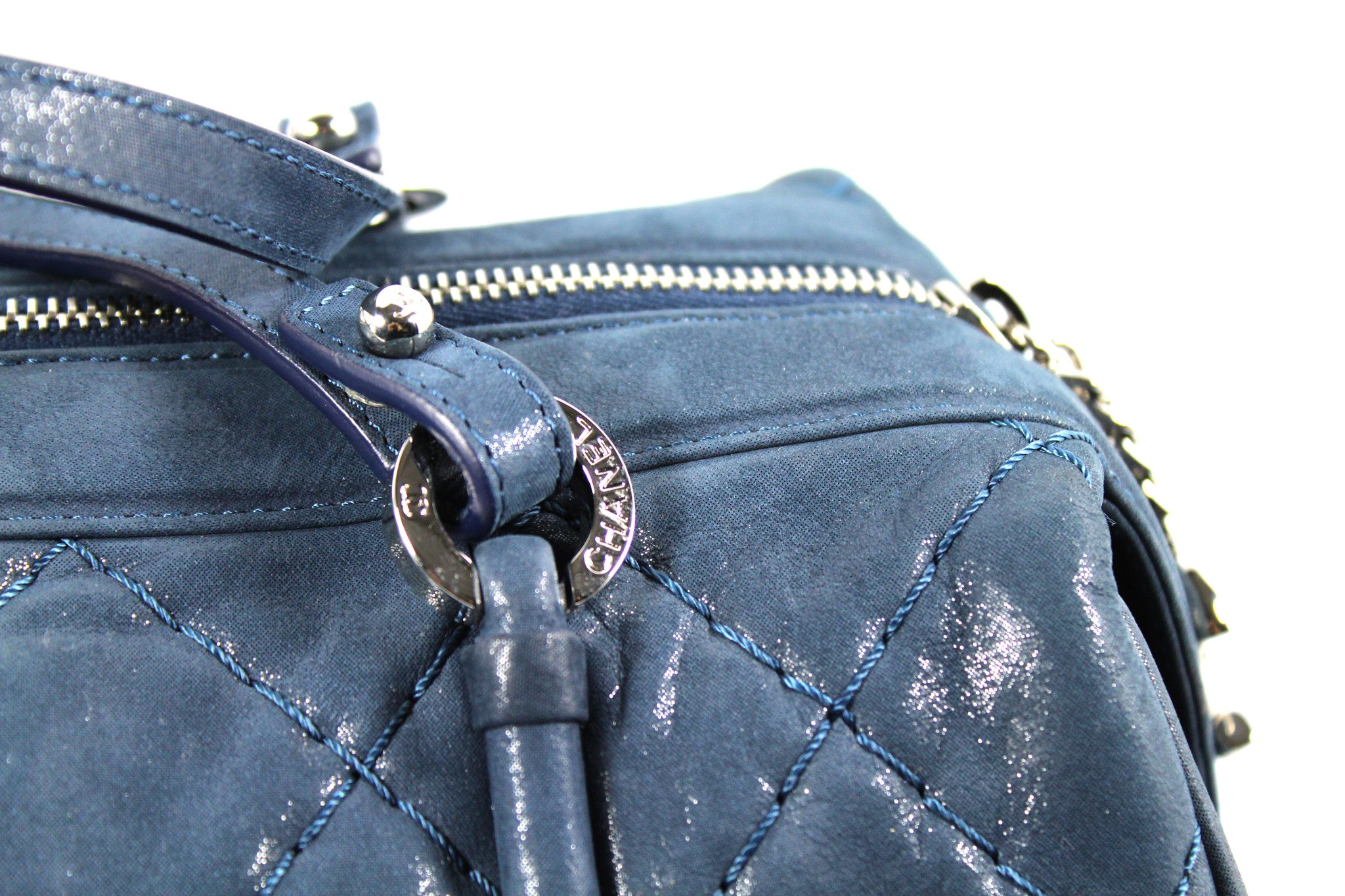 Chanel Metallic Blue Leather Quilted Duffle Bag - Encore Consignment - 2