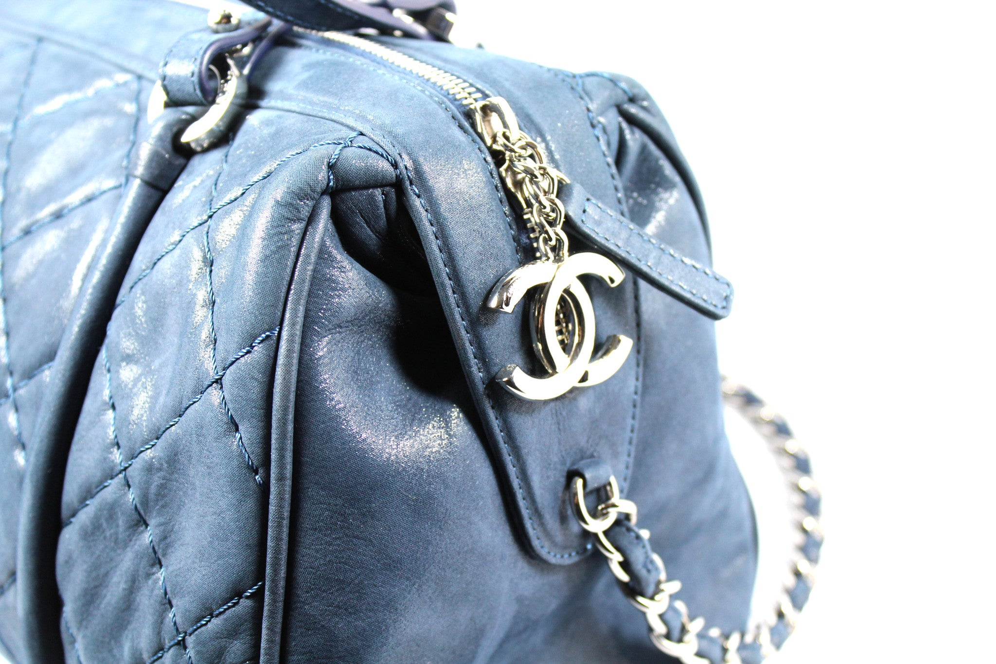 Chanel Metallic Blue Leather Quilted Duffle Bag - Encore Consignment - 4