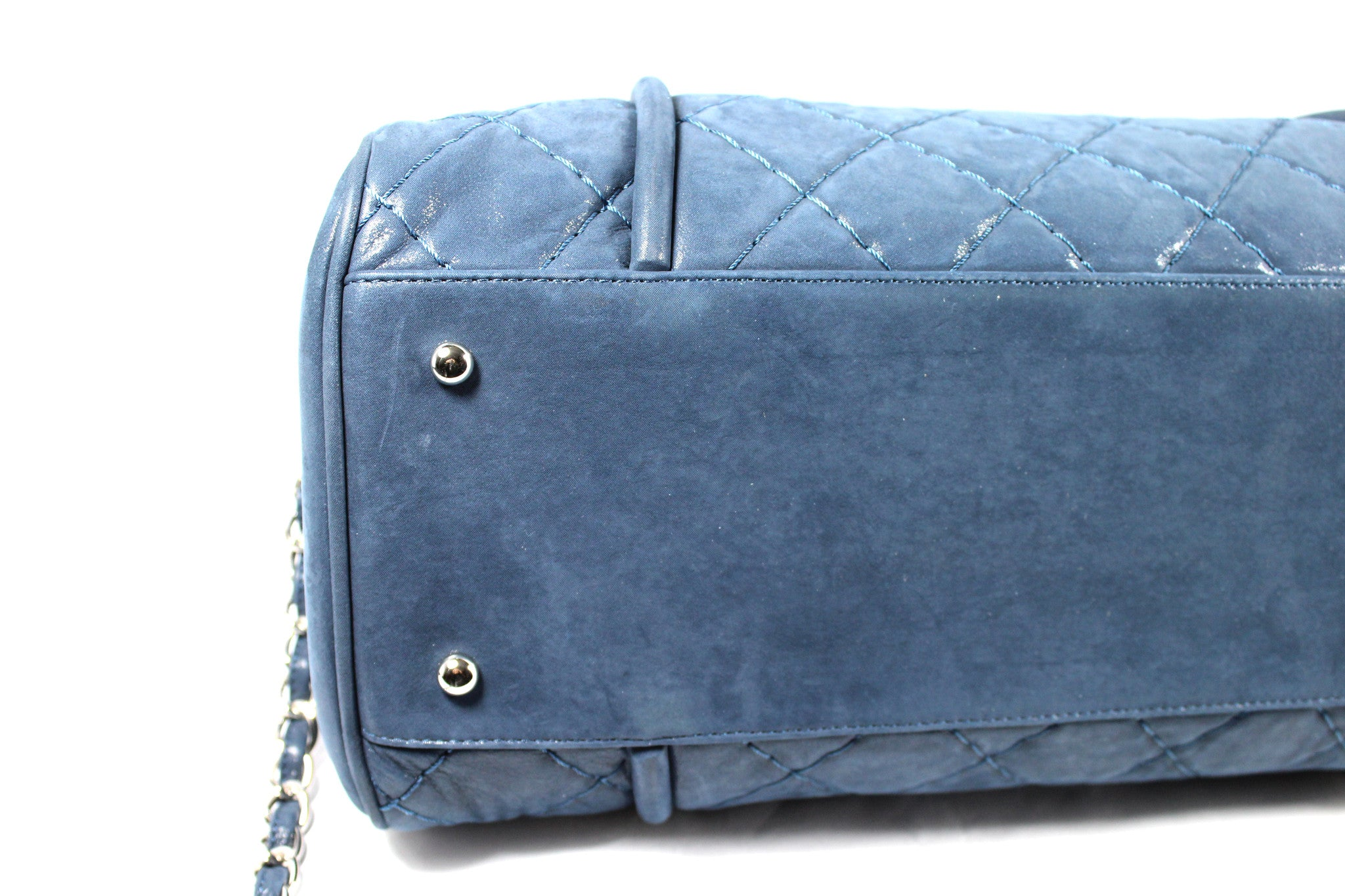 Chanel Metallic Blue Leather Quilted Duffle Bag - Encore Consignment - 13
