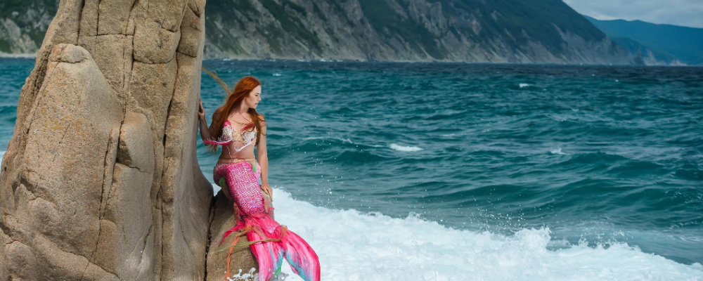 Mermaid on a rock ocean