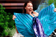 Load image into Gallery viewer, Sequin mermaid tail made with reversible mermaid sequin fabric. Teal blue and purple sequin mermaid tail