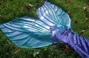 Sequin mermaid tail made with reversible mermaid sequin fabric. Teal blue and purple sequin mermaid tail