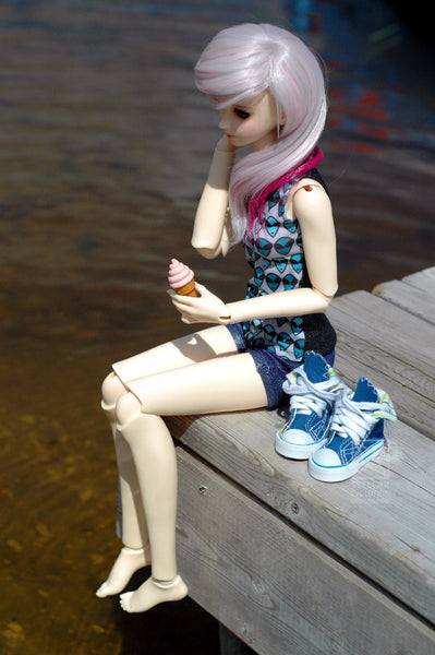 bjd with ice cream on a dock by a lake
