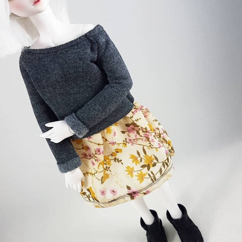 close up look of the sleeve cuffs and skirt of this doll dress