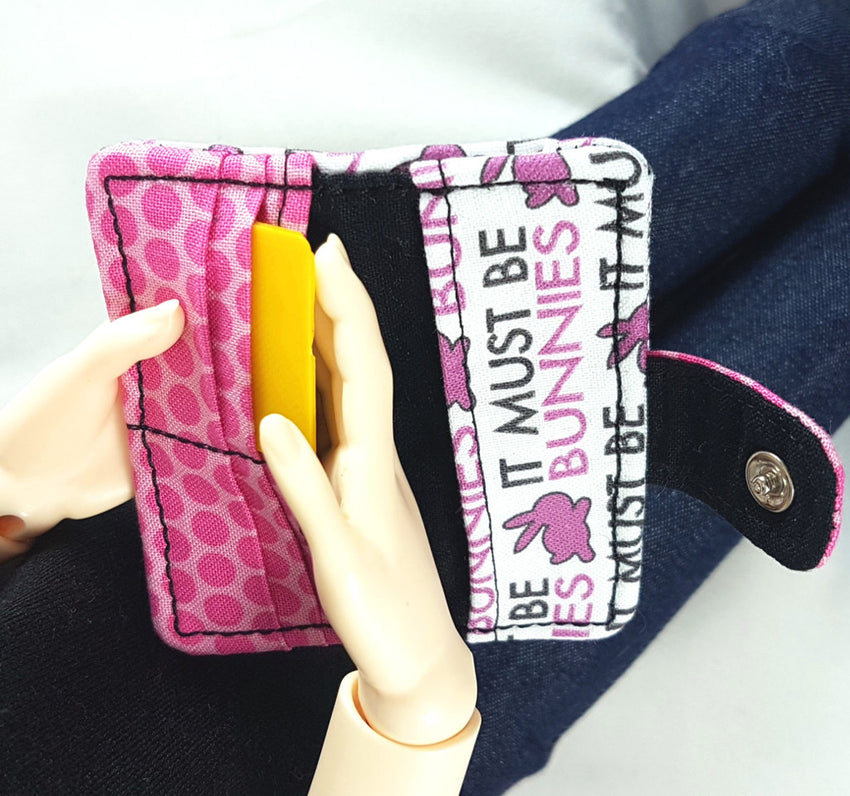 Ball jointed doll wallet complete with credit card