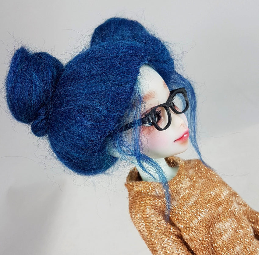 side view of small yosd glasses on doll with blue wig