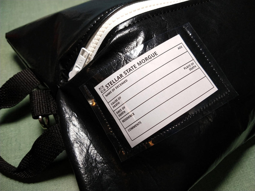 bjd carrying bag shapped like a body bag including a morgue tag for identification