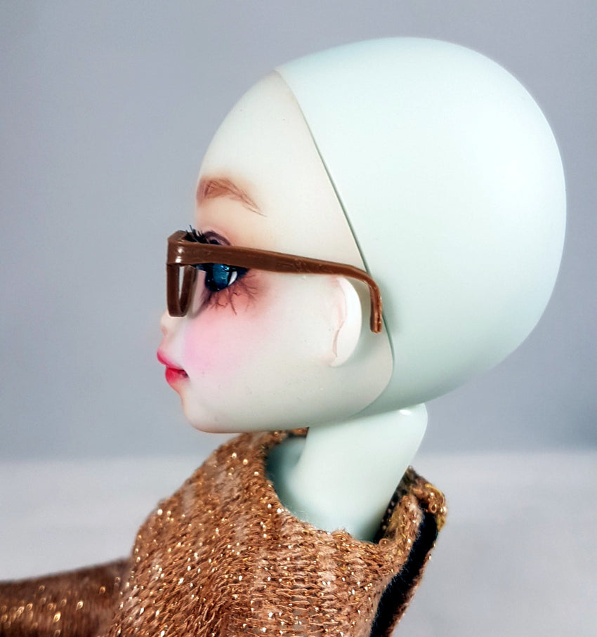 side view of small yosd glasses on doll