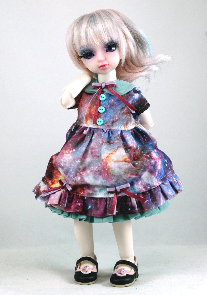 bella from angell studios modelling a handmade galaxy dress from stellar evolution designs