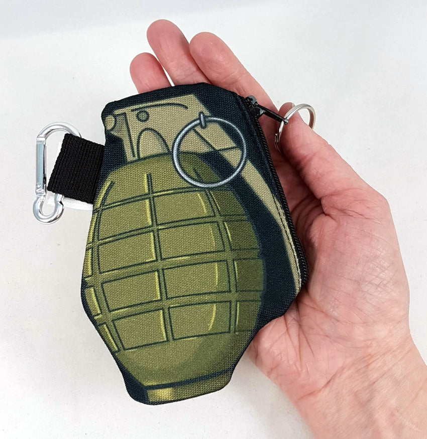 grenade coin purse in hand for size and scale