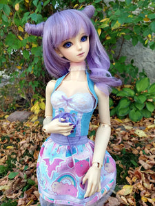 sd bjd modelling a blue corset, white lace top and kawaii pastel skirt