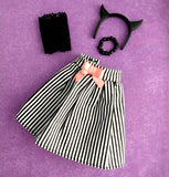 demon headband, black pearls necklace, black lace top, black white striped skirt