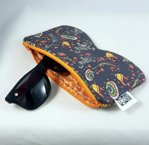 sunglasses sticking out of handmade sunglasses case with zipper