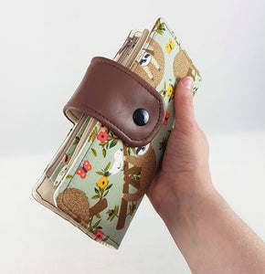 sloth wallet in hand
