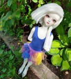 overhead view of little sophia bjd in rainbow skirt set