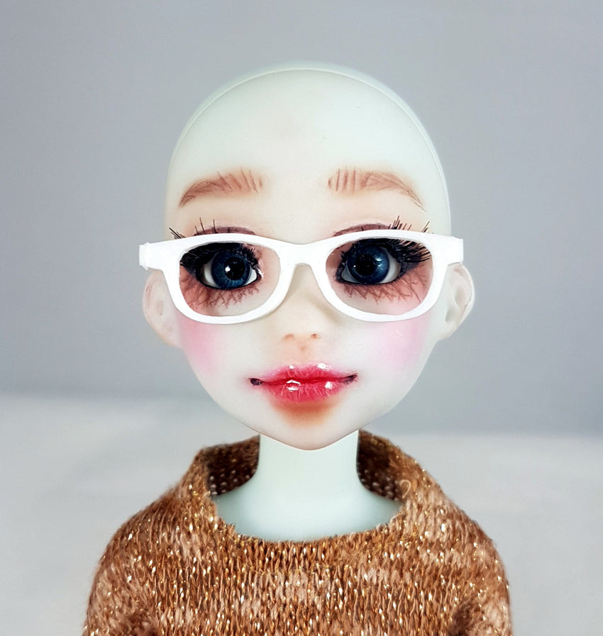 front view of doll wearing white glasses