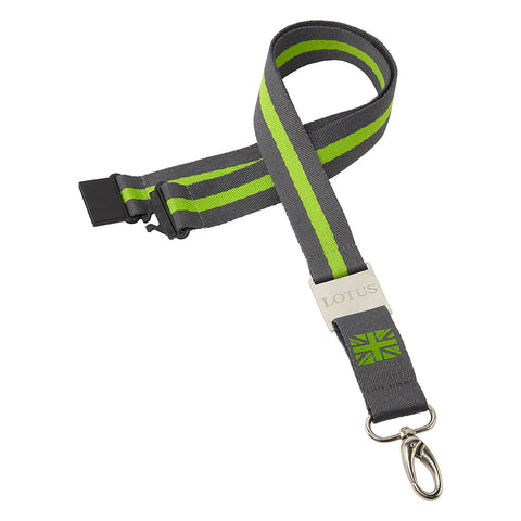 Lotus Cars Lanyard. Featuring a modern grey and lime green stripe down the lanyard to meet the bold Lotus engraved metal joiner with a mono GB flag and metal lobster claw clasp.