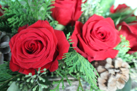 Closeup of roses in rustic DIY Christmas centerpiece