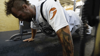 weighted-smith-machine-pushup-a