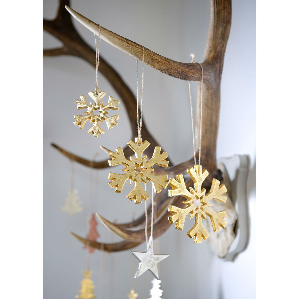 Set Of 3 Gold Cast Snowflakes