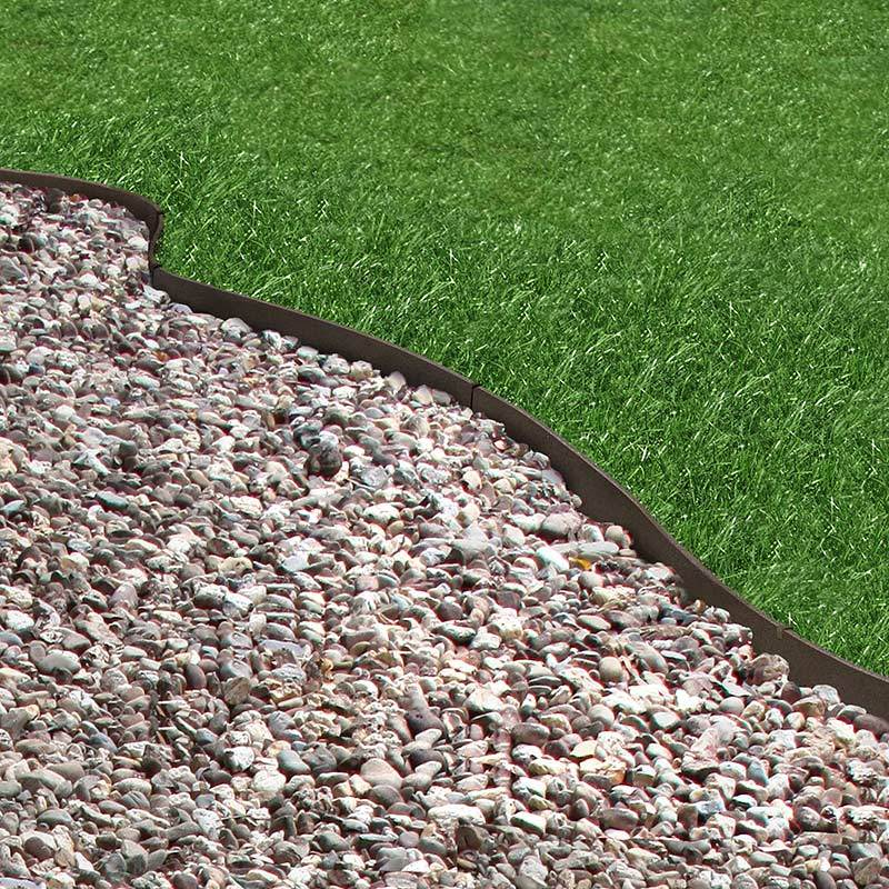 Core Edge Flexible Steel Lawn Edging show in Brown edging dividing grass from gravel path - Henderson Garden Supply