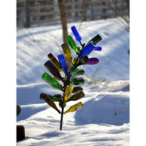 Wine Bottle Tree shown in snowy background - Henderson Garden Supply