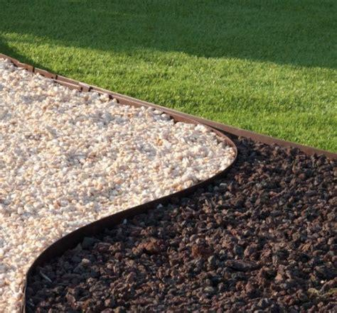 Core Edge Flexible Steel Lawn Edging show in Brown edging dividing grass from gravel path - Edge It Co by Henderson Supply