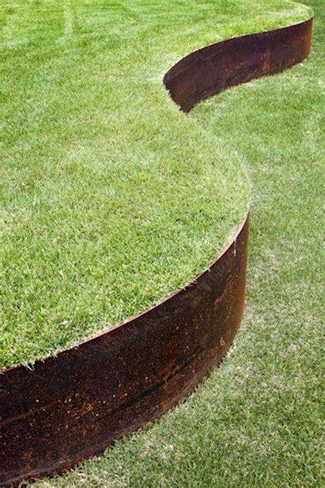 Core Edge Flexible Steel Lawn Edging show in CorTen edging shown bordering yard - Henderson Garden Supply