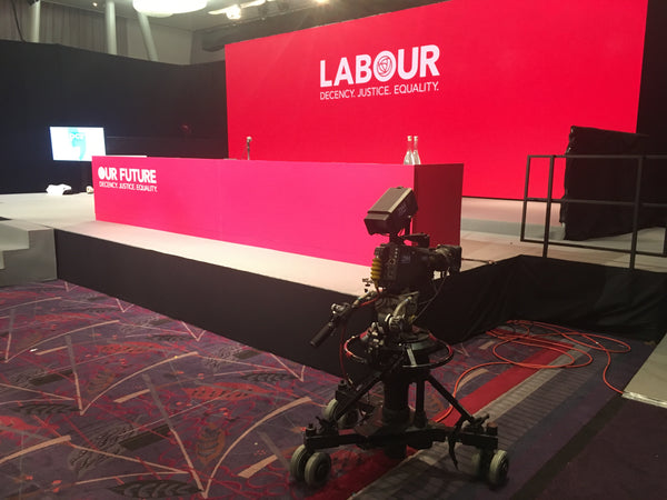 The stage set of the Labour Party conference showing the foam table wrap made by Barrow Signs