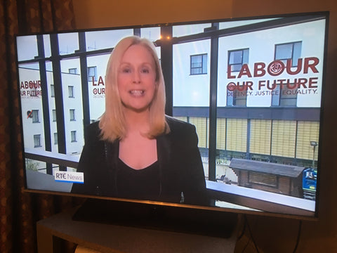Screen Grab from RTE News showing window decals by barrow signs