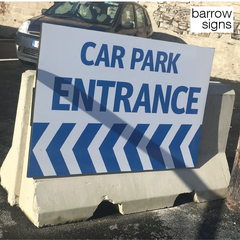 Car Park entrance sign mounted high on a precast concrete barrier