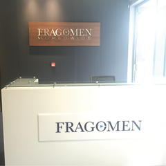 Fragomen Reception area Dublin, Ireland with Walnut Panel and Brushed Stainless Steel lettering by Barrow Signs