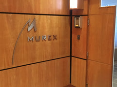 Brushed stainless steel lettering on veneered timber panel