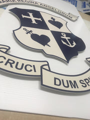 Vinyl lettering being applied to cnc routed and powder coated 3d aluminium logo shape at barrow signs