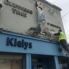 The first piece of the Guinness Sign being removed by Barrow Signs at Kiely's of Donnybrook