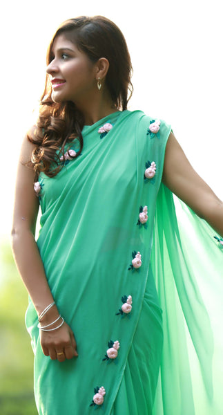 Baby Pink Rose Flowers on a Sea Green Pure Silk Georgette Saree
