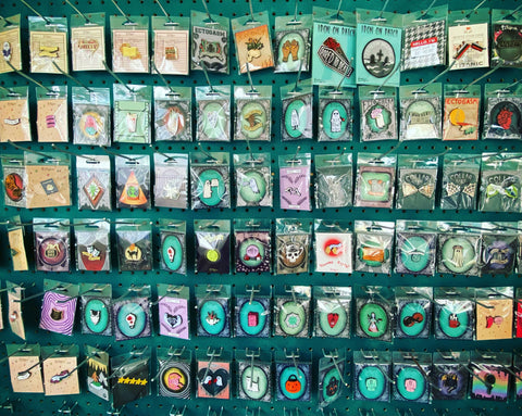 A cool store display of enamel pins.