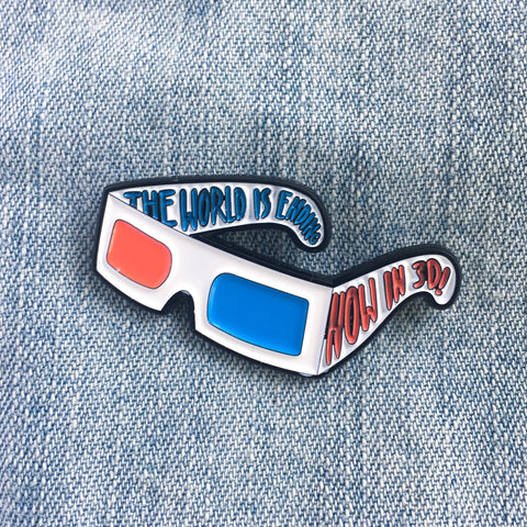 """The World is Ending... Now in 3D!"" Movie enamel pin."